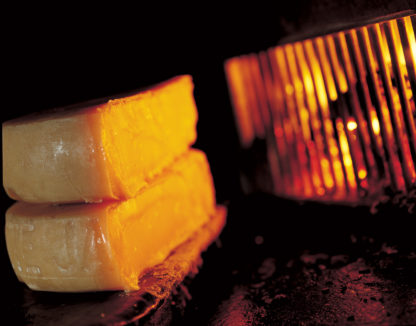 Traditional Swiss raclette over the open fire