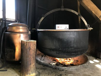 The curd is cooked over a wooden fire